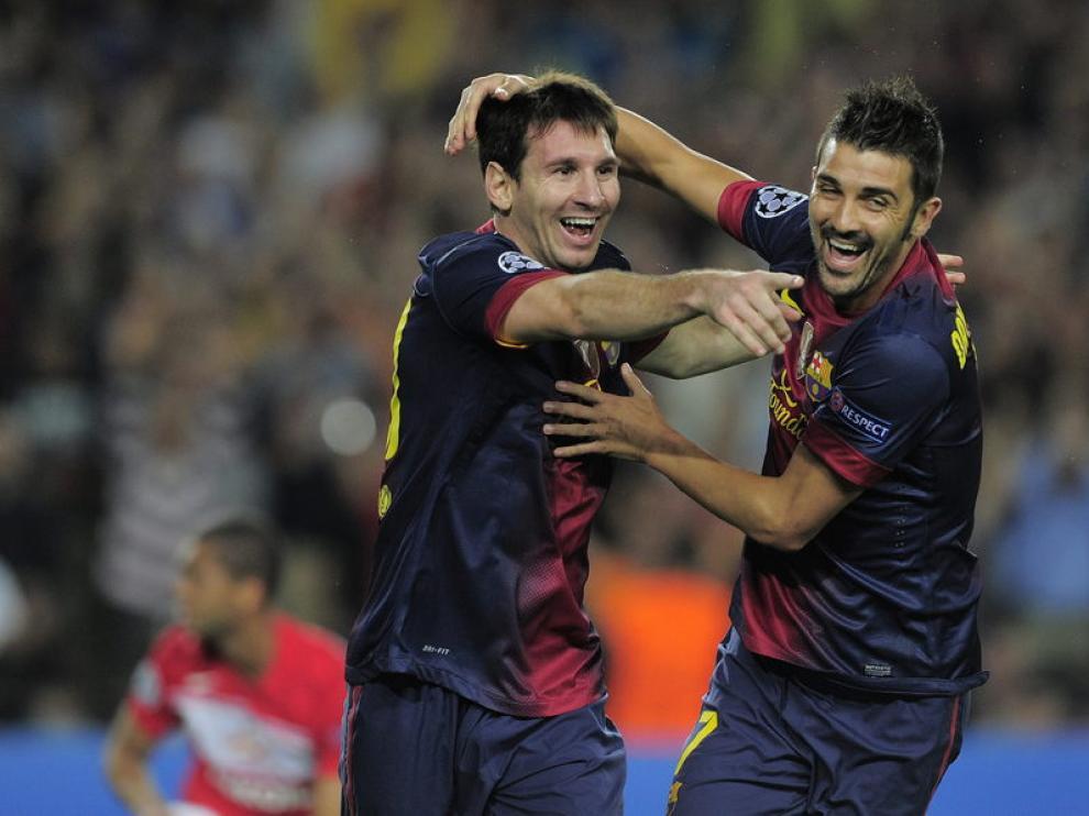 Villa celebra una diana con su compañero Messi