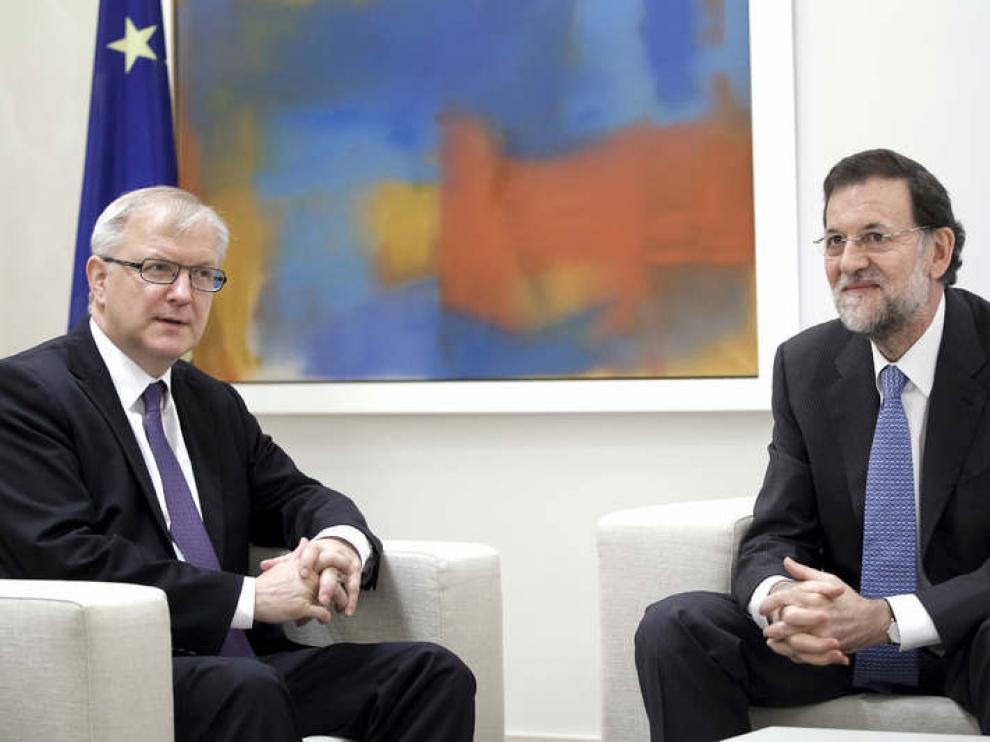 Olli Rehn y Mariano Rajoy
