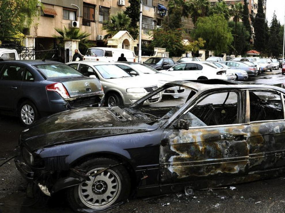 Desperfectos causados por un coche bomba en Damasco