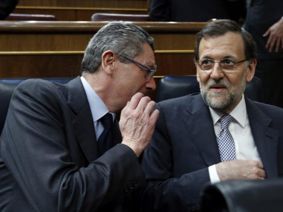 Gallardón y Rajoy durante el debate sobe el estado de la Nación.