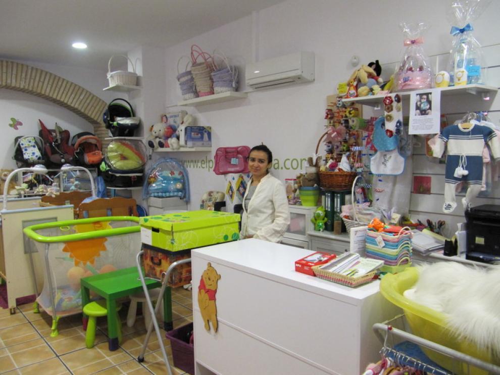 Tienda de segunda mano para bebés en el Arrabal