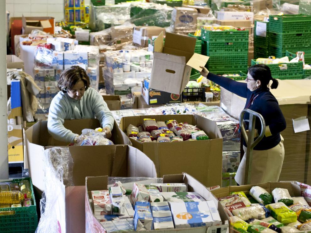 Labores de recogida y entrega de los alimentos por parte de los voluntarios