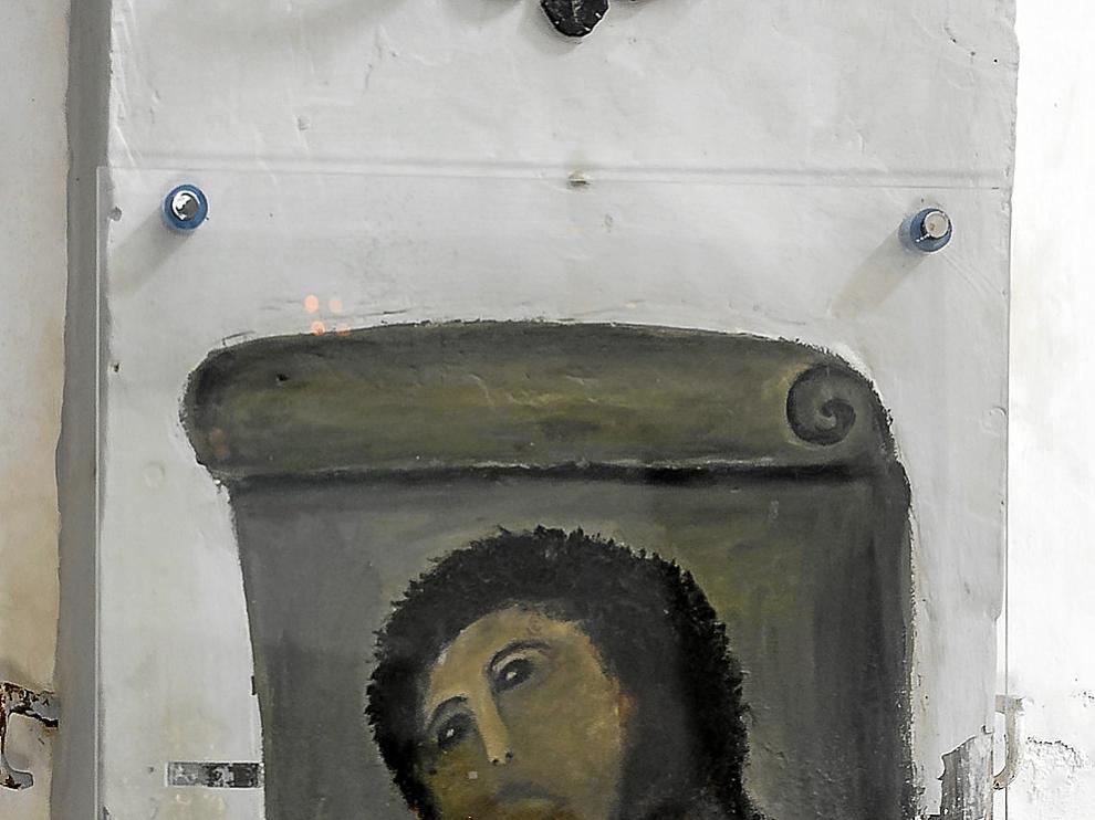 La pintura del eccehomo, tal cual quedó después de la restauración fallida.
