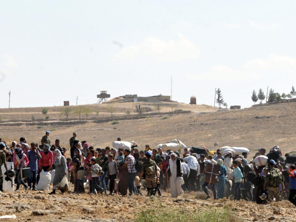 Refugiados sirios, en la frontera con Turquía, huyendo del Estado Islámico