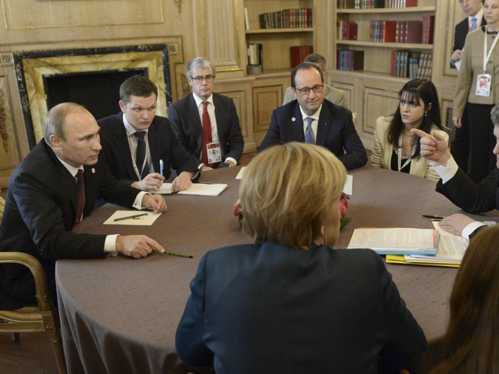Putin y Poroshenko durante reuniones bilaterales
