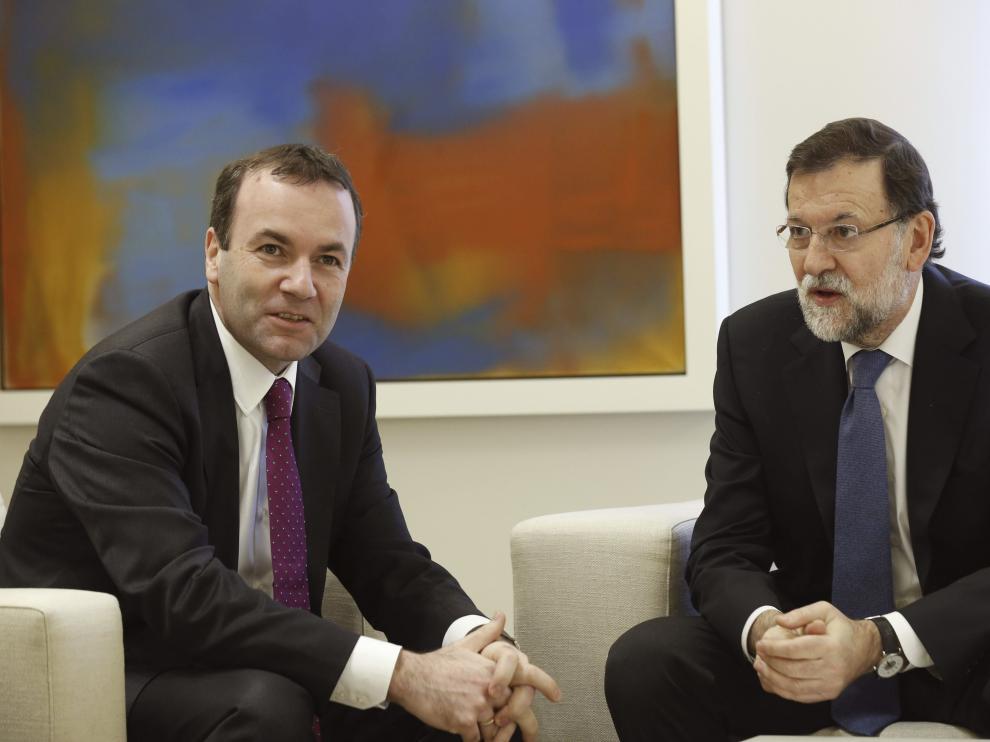 Mariano Rajoy junto a Manfred Weber