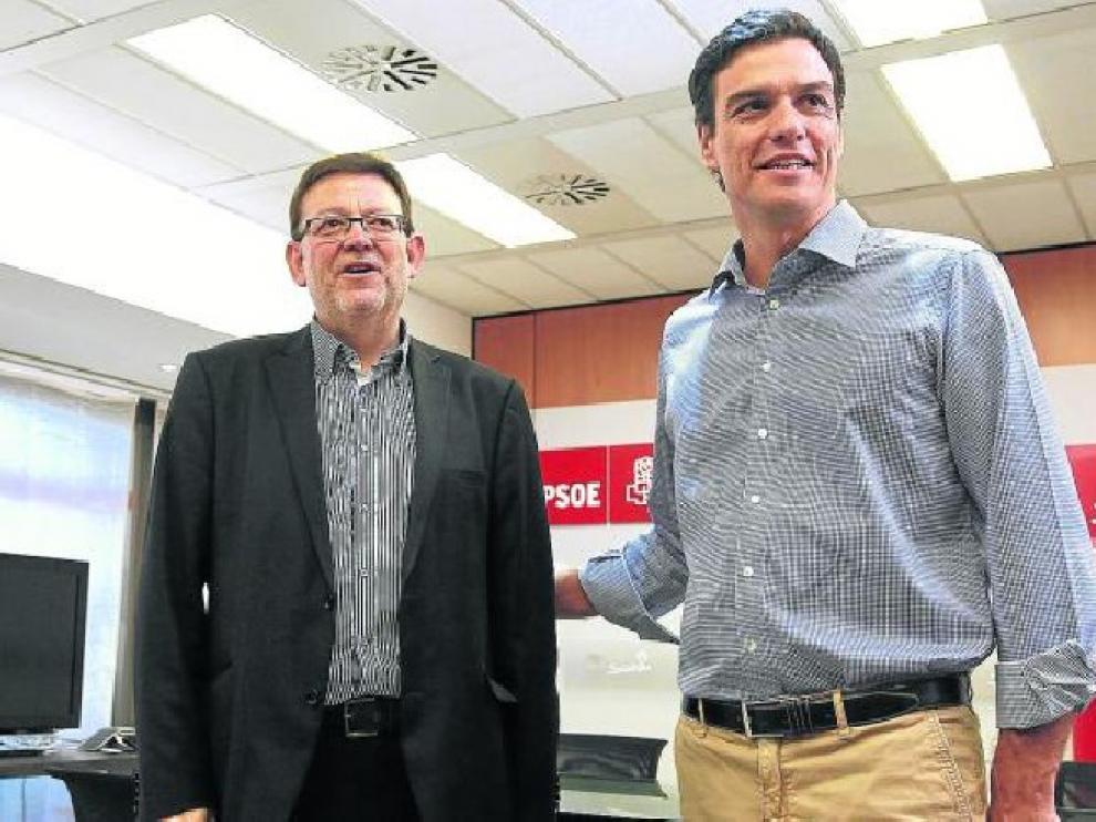 Pedro Sánchez, en julio junto al secretario general del PSOE valenciano, Ximo Puig.