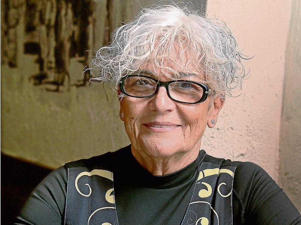Dora Gracia, con una ración de jabalí y robellones