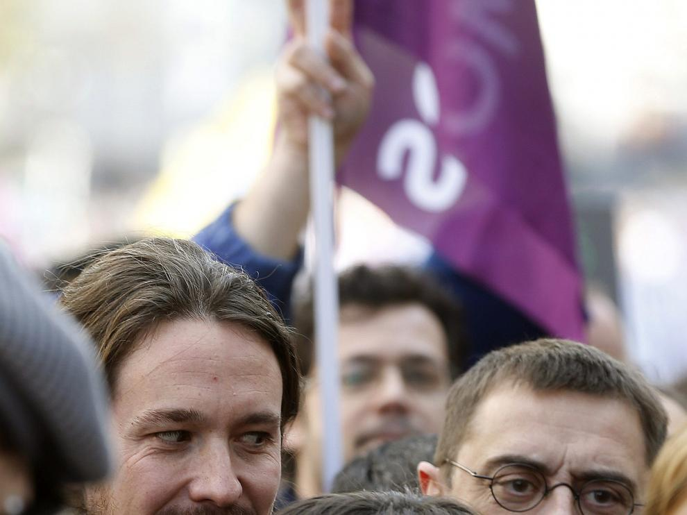 """El líder de Podemos, Pablo Iglesias, y el número tres, Juan Carlos Monedero, durante la """"marcha del cambio"""","""