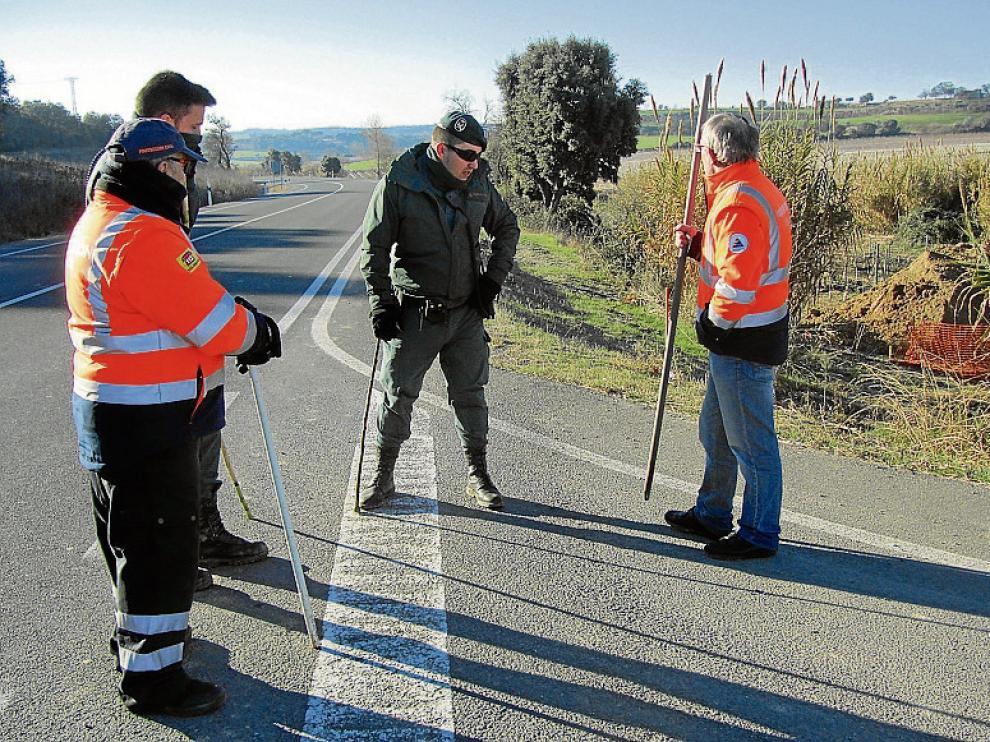 Guardia Civil y voluntarios de Protección Civil durante el rastreo.