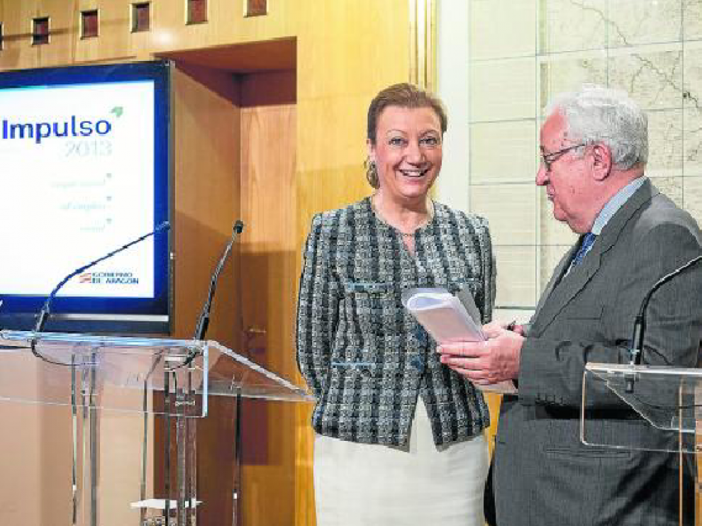 La presidenta de Aragón, Luisa Fernanda Rudi, y el líder del PAR, José Ángel Biel, en la presentación del plan.