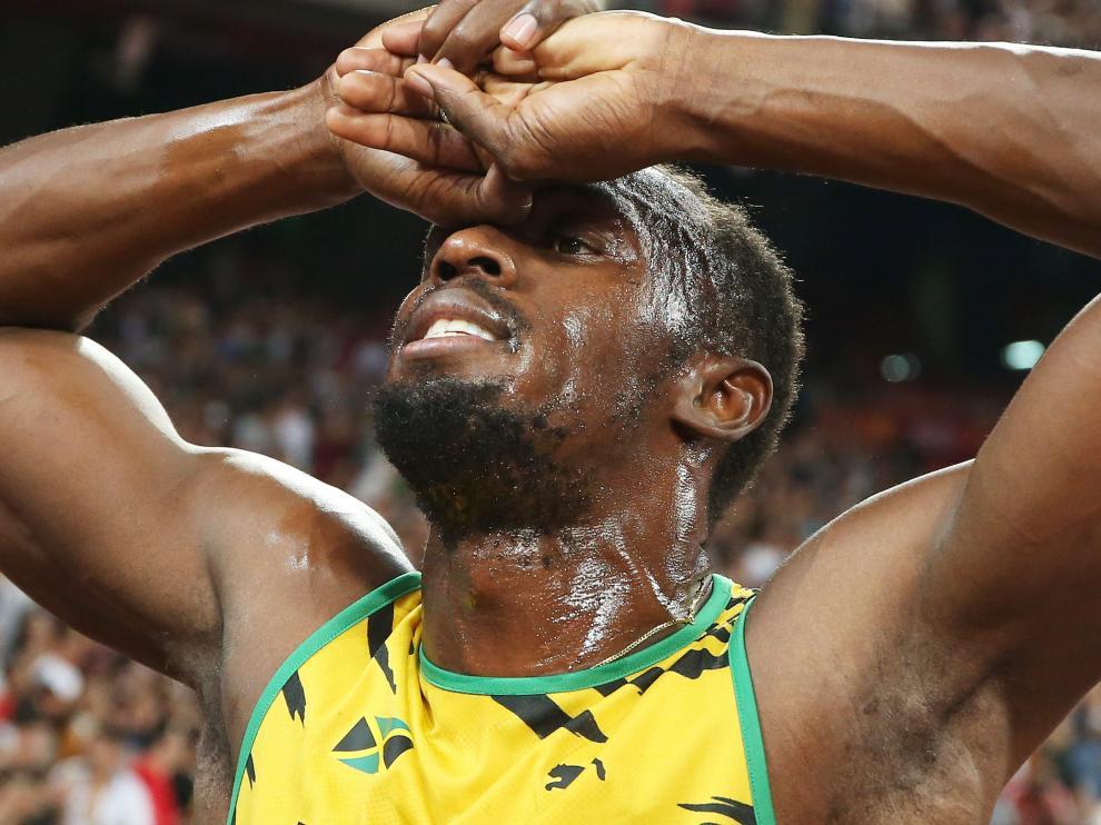 Bolt consigue tres oros en Pekín