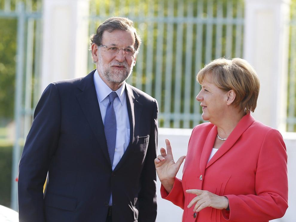 El presidente del Gobierno español, Mariano Rajoy y la canciller alemana, Angela Merkel.