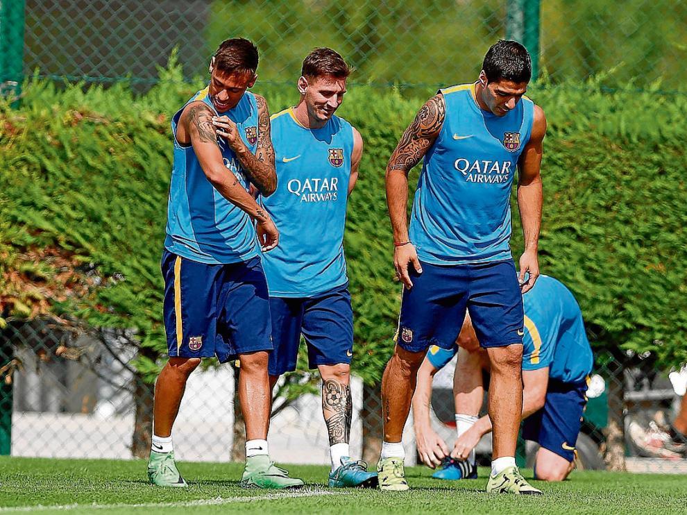 El tridente azulgrana –Neymar, Messi y Suárez–, ayer en el entrenamiento del FC Barcelona.