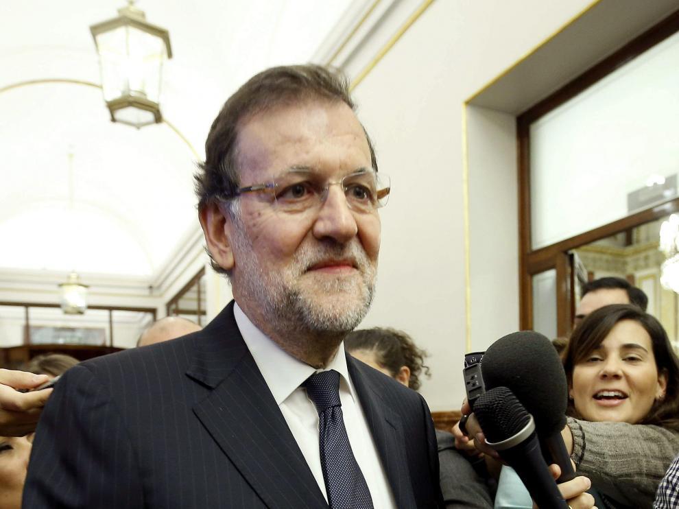 El jefe del Ejecutivo, Mariano Rajoy, a su llegada esta mañana al Congreso de los Diputados para asistir a la última sesión de control al Gobierno con la que la Cámara Baja pone fin hoy a la X legislatura