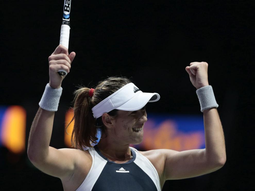 La tenista española Garbiñe Muguruza celebra su triunfo contra la checa Lucie Safarova.
