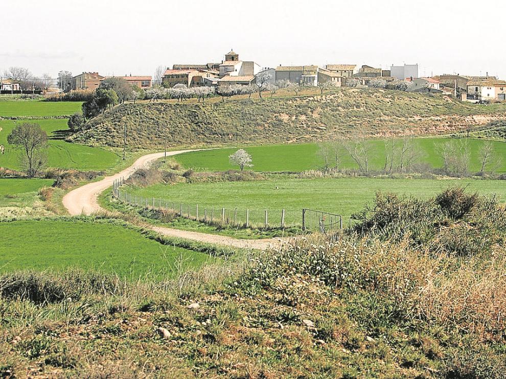 Oposición política y vecinal. La concesionaria del vertedero de residuos industriales no peligrosos de Huesca adquirió, con el visto bueno de la Administración, unas 25 hectáreas situadas a 1,5 kilómetros del barrio pedáneo de Cuarte -en la fotografía- en