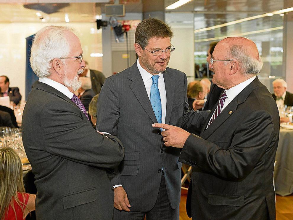 Forges y el ministro Catalá, ayer junto a Carlos Carnicer.