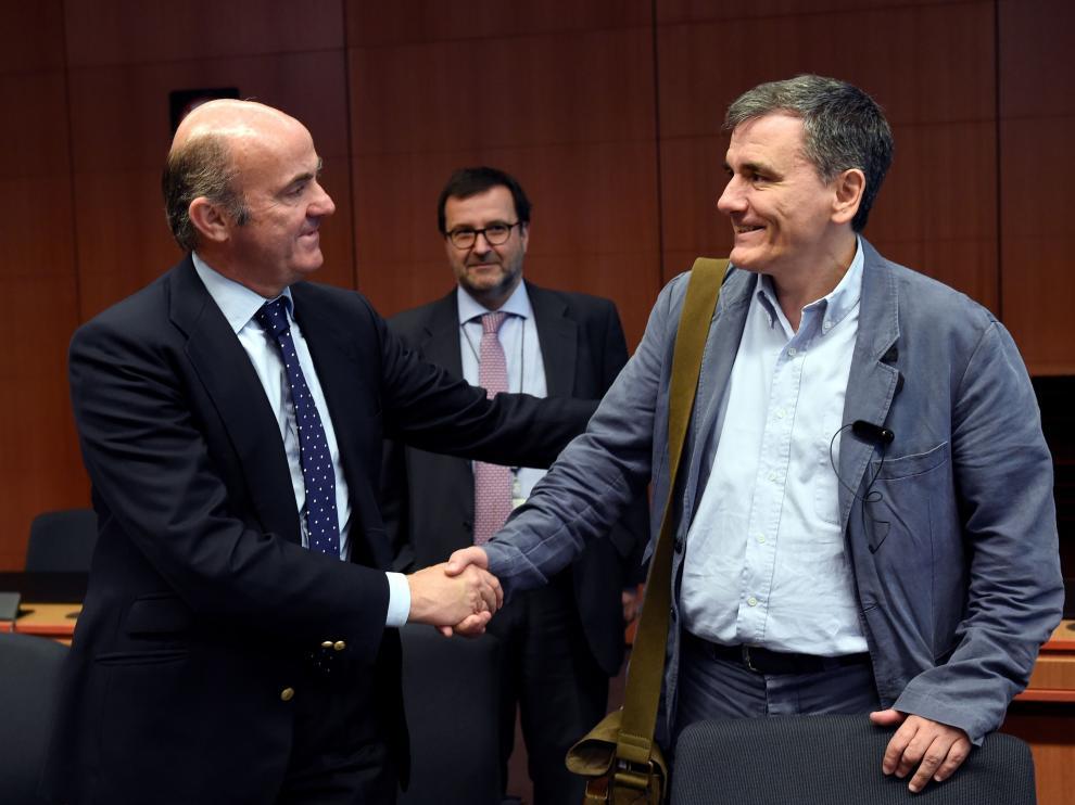De Guindos junto al ministro de finanzas griego.