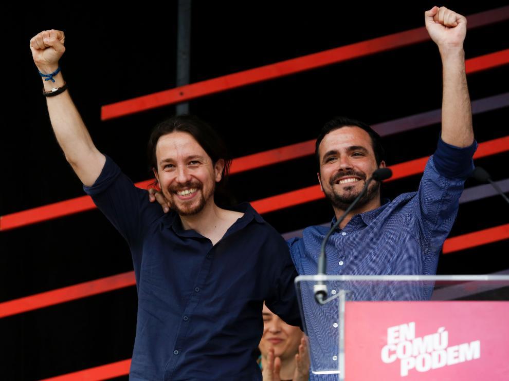 El candidato de Podemos, Pablo Iglesias y el líder de Izquierda Unida, Alberto Garzón.