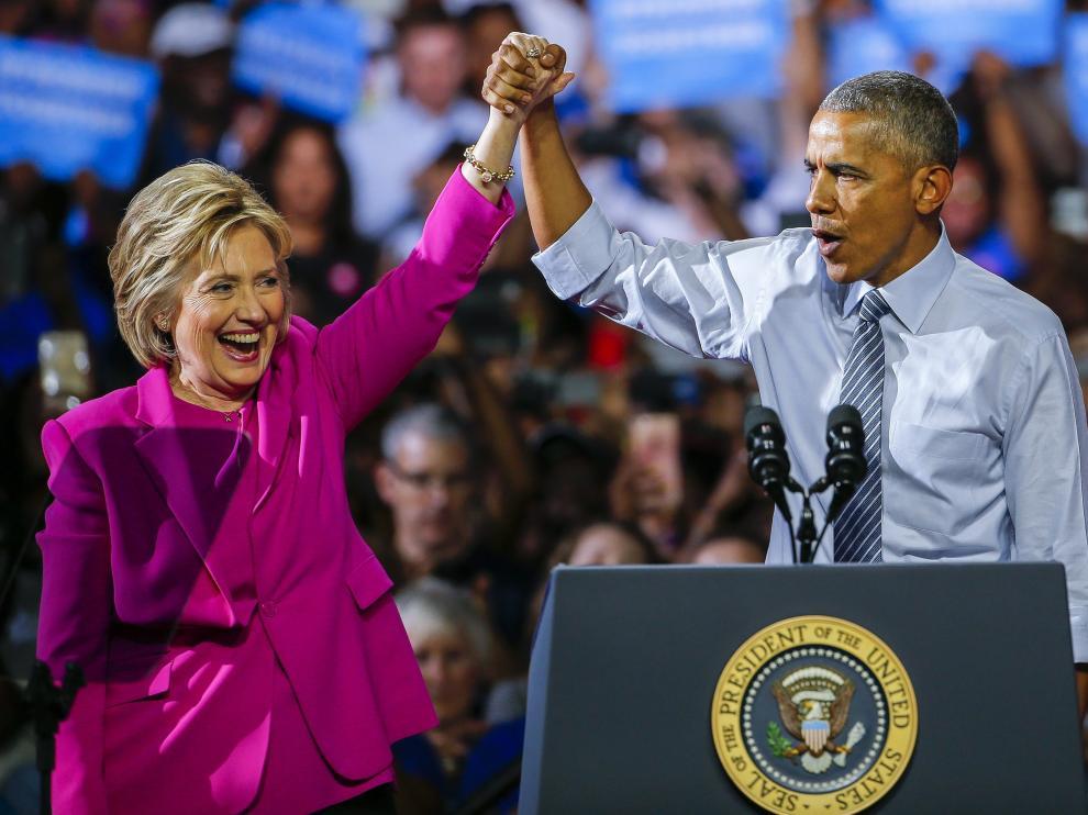 Obama, junto a Clinton este martes.