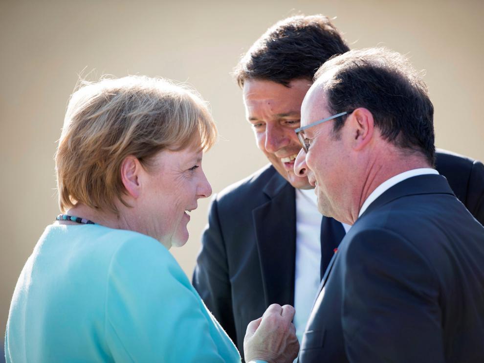 Los tres líderes reunidos en Italia.