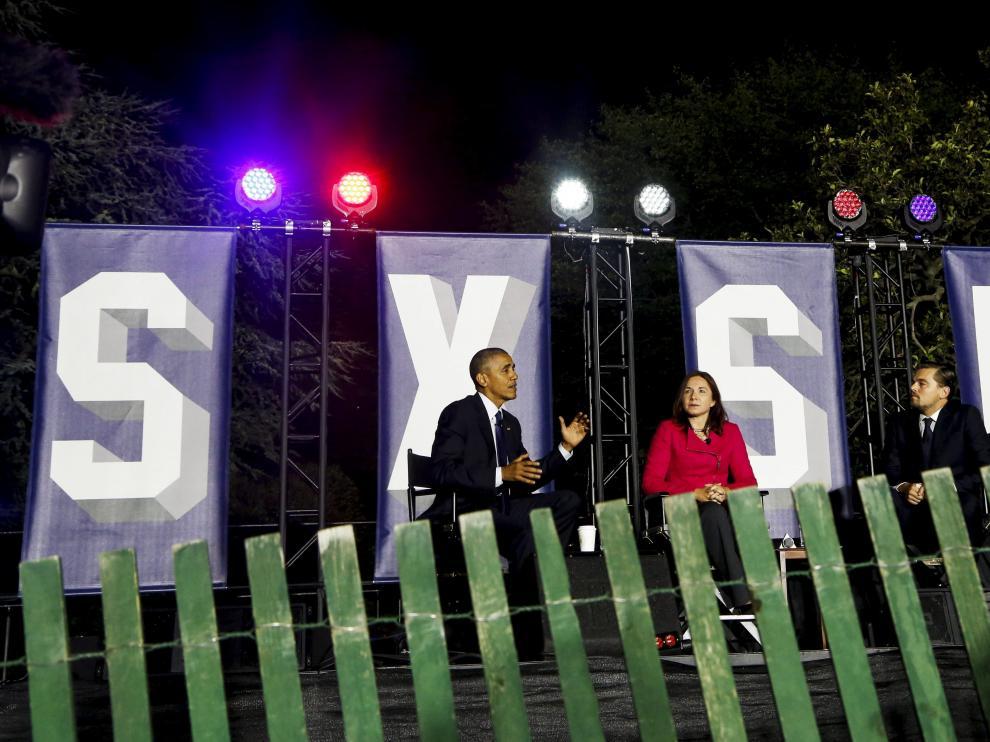 Obama y DiCaprio en el debate sobre el cambio climático celebrado dentro del festival 'South By South Lawn'.