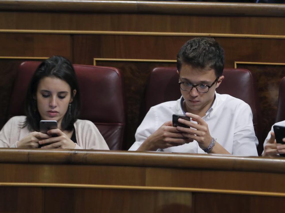Irene Montero, Íñigo Errejón y Pablo Iglesias durante el debate de este jueves en el Congreso.