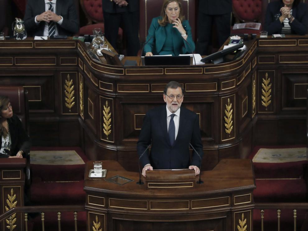 El líder del PP y presidente del Gobierno en funciones, Mariano Rajoy, durante su intervención en el debate de su investidura, esta tarde en la Cámara Baja.