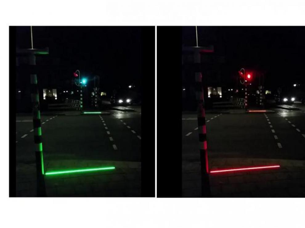 El sistema ilumina con una línea roja y verde el suelo.