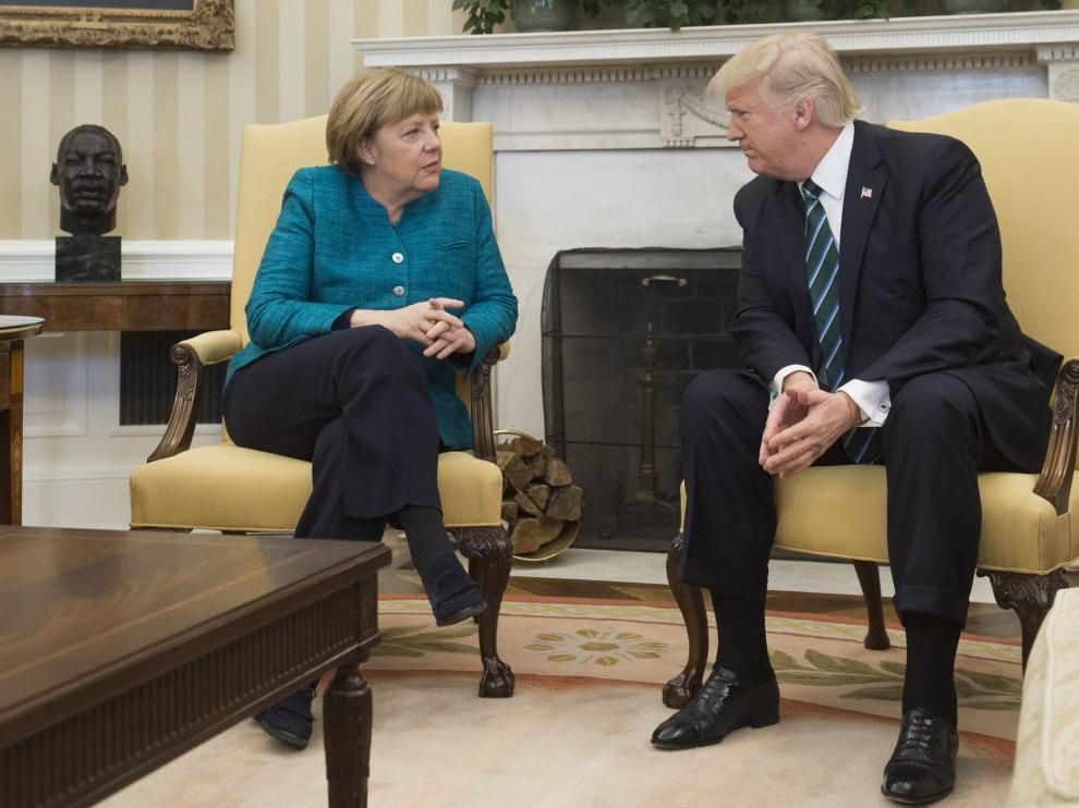 Trump y  Merkel, este viernes en su reunión en la Casa Blanca.