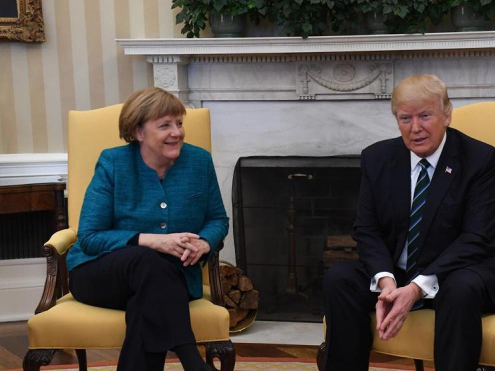 Trump y Merkel en la reunión de este viernes.