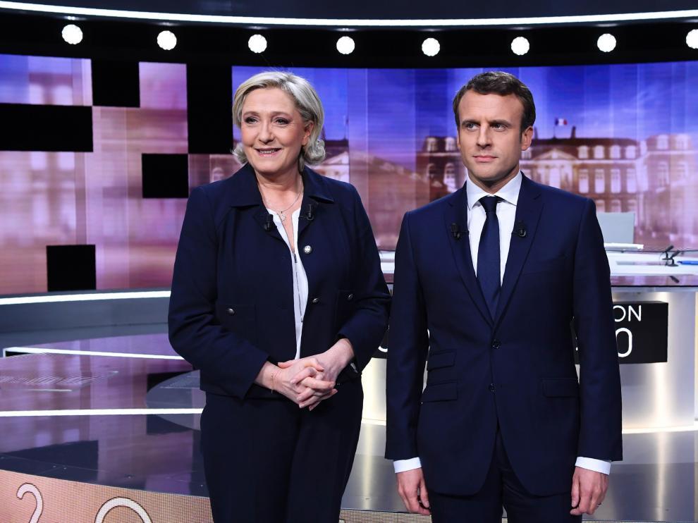 Le Pen y Macron, antes del debate de este miércoles.