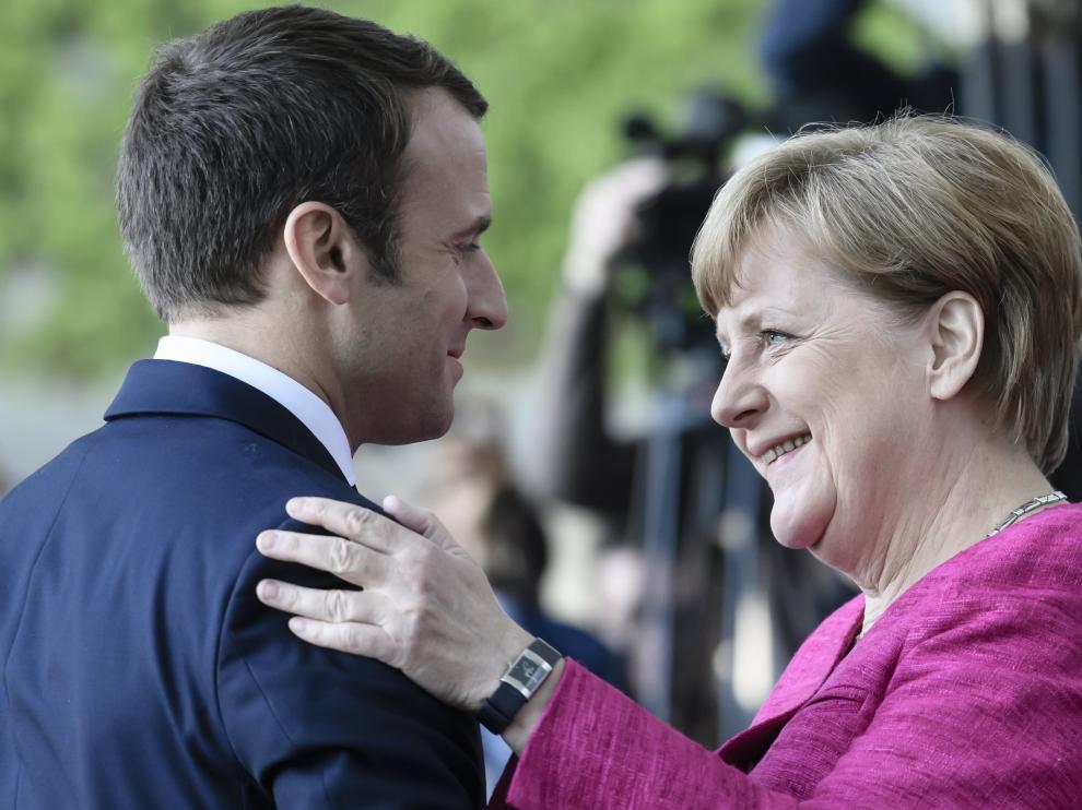Macron y Merkel en una reunión.