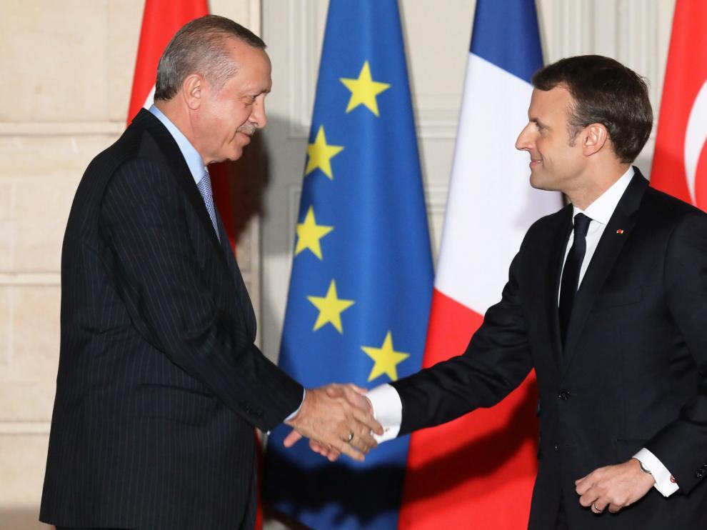El presidente turco, Erdogan, junto a su homólogo francés, Emmanuel Macron.