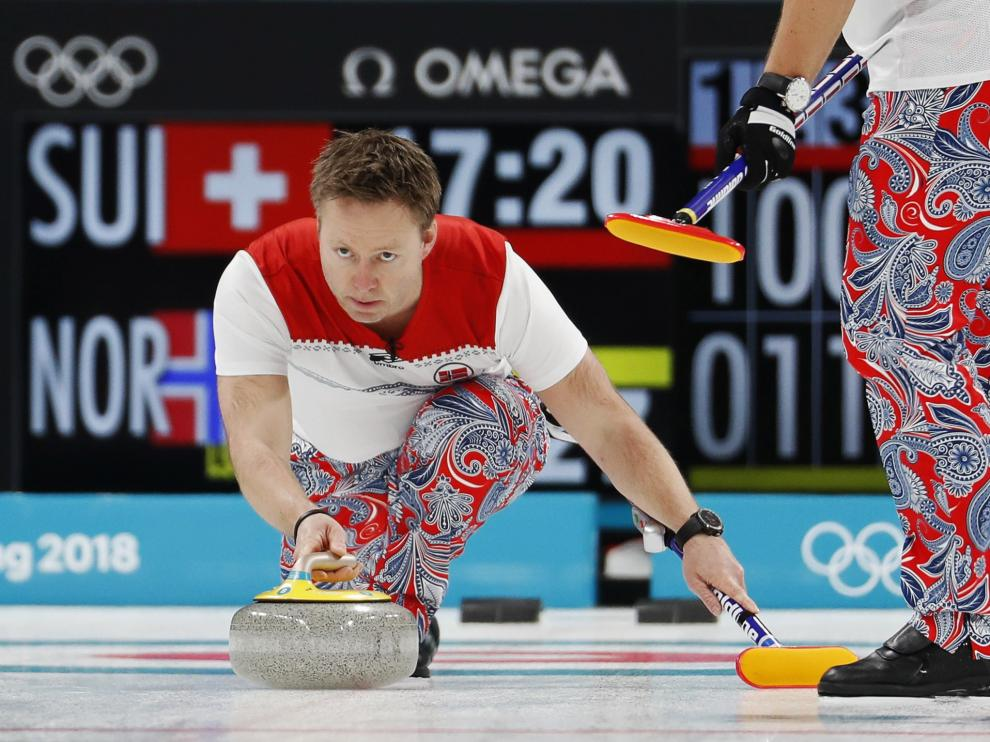Cachemires estilosos para un partido de curling.