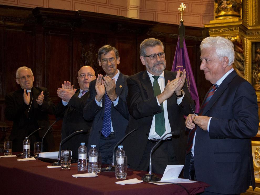 Eusebio Hernández, Jacinto Julve, Jose María Rivera y José A. Mayoral aplauden a García Vicente.