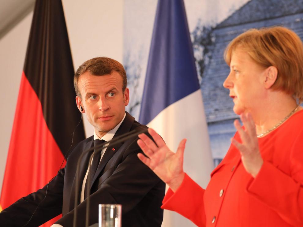 Merkel y Macron acuerdan un presupuesto común para la eurozona y un fondo de rescate como el FMI