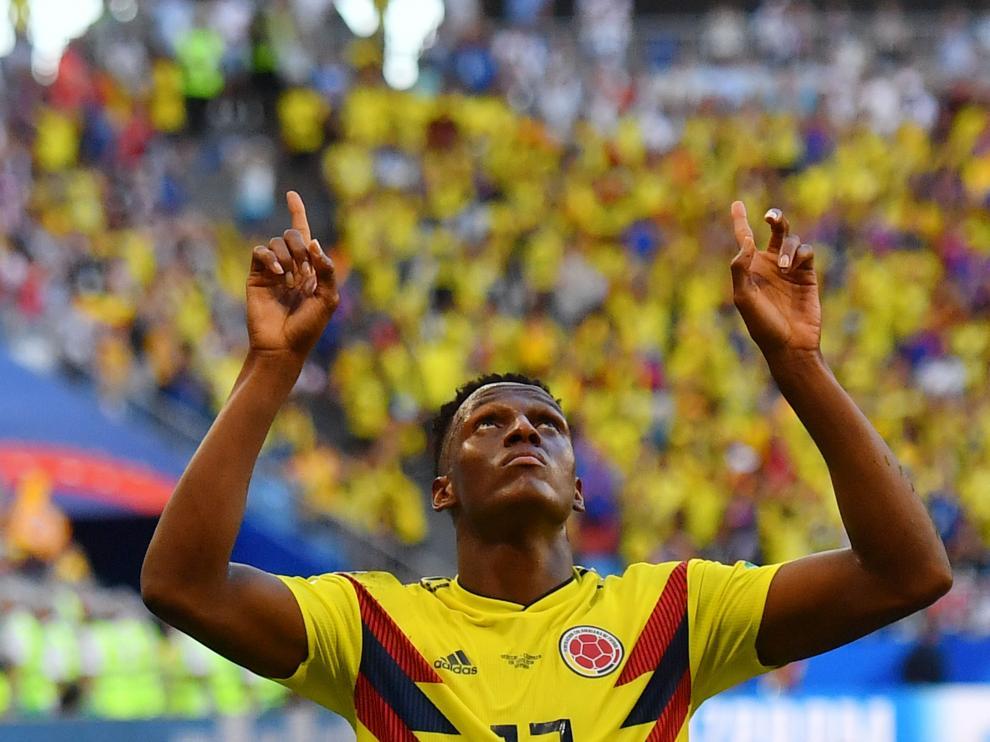 Yerry Mina celebra el único tanto del partido.
