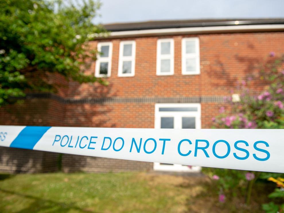 Cordón policial en la propiedad en la que fueron encontrados los intoxicados.