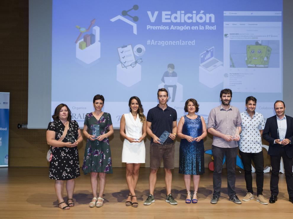 Foto de familia de los premiados, en el escenario de Caixaforum.