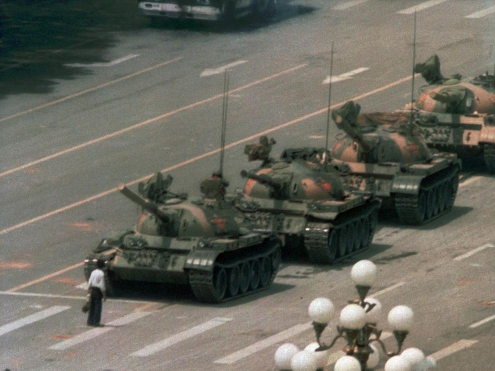 ** FILE ** A Chinese man stands alone to block a line of tanks heading east on Beijing's Changan Blvd. near Tiananmen Square in this June 5, 1989 file photo. Friday June 4, 2004 marks the 15th anniversary of the military crackdown on a student-led demonstration for democratic reform and against government corruption, which left hundreds, possibly thousands dead. (AP Photo/Jeff Widener, File)   CHINA TIANANMEN ANNIVERSARY