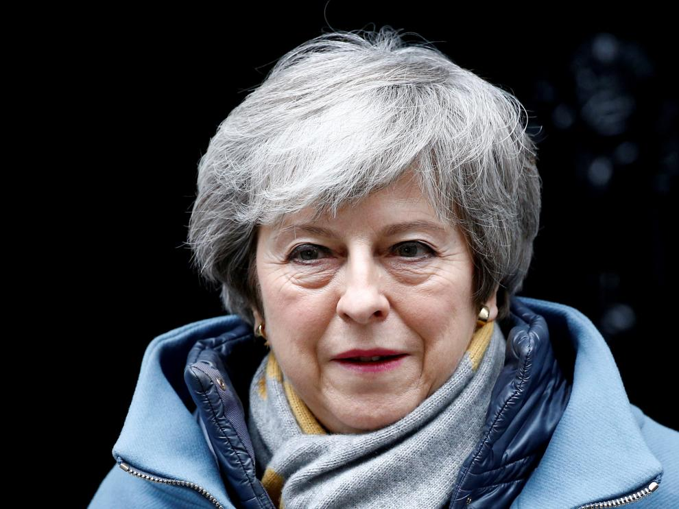 FILE PHOTO: British Prime Minister Theresa May walks outside Downing Street, as she faces a vote on Brexit, in London, Britain March 13, 2019. REUTERS/Henry Nicholls/File Photo [[[REUTERS VOCENTO]]] BRITAIN-EU/