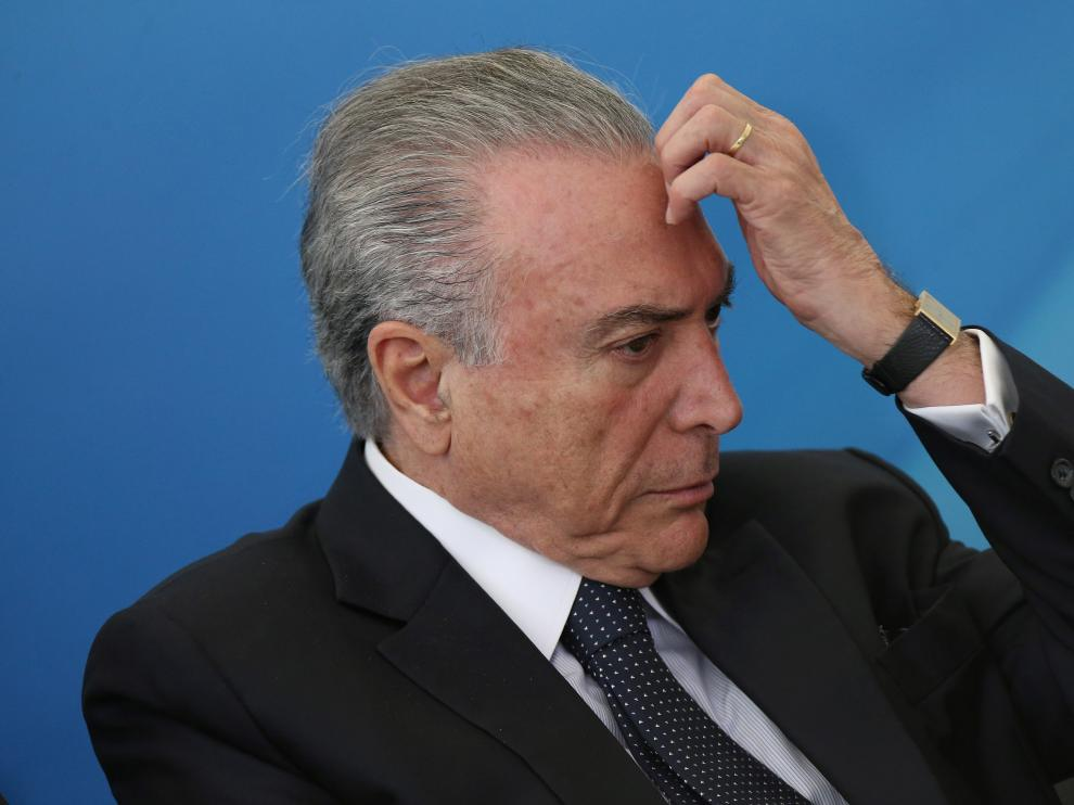 FILE PHOTO:  Former Brazil's President Michel Temer gestures during a ceremony to launch the new program of the Brazilian state development lender BNDES at the Planalto Palace in Brasilia, Brazil August 23, 2017. Picture taken December August 23, 2017. REUTERS/Adriano Machado/File Photo [[[REUTERS VOCENTO]]] BRAZIL-CORRUPTION/