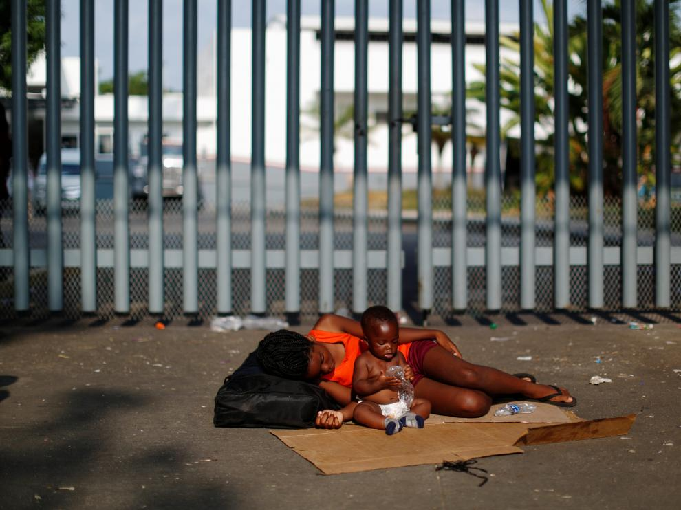 A Congolese child and girl are seen during a protest at the premises of the National Migration Institute (INM), in Tapachula, Mexico April 9, 2019. REUTERS/Jose Cabezas [[[REUTERS VOCENTO]]] USA-IMMIGRATION/MEXICO