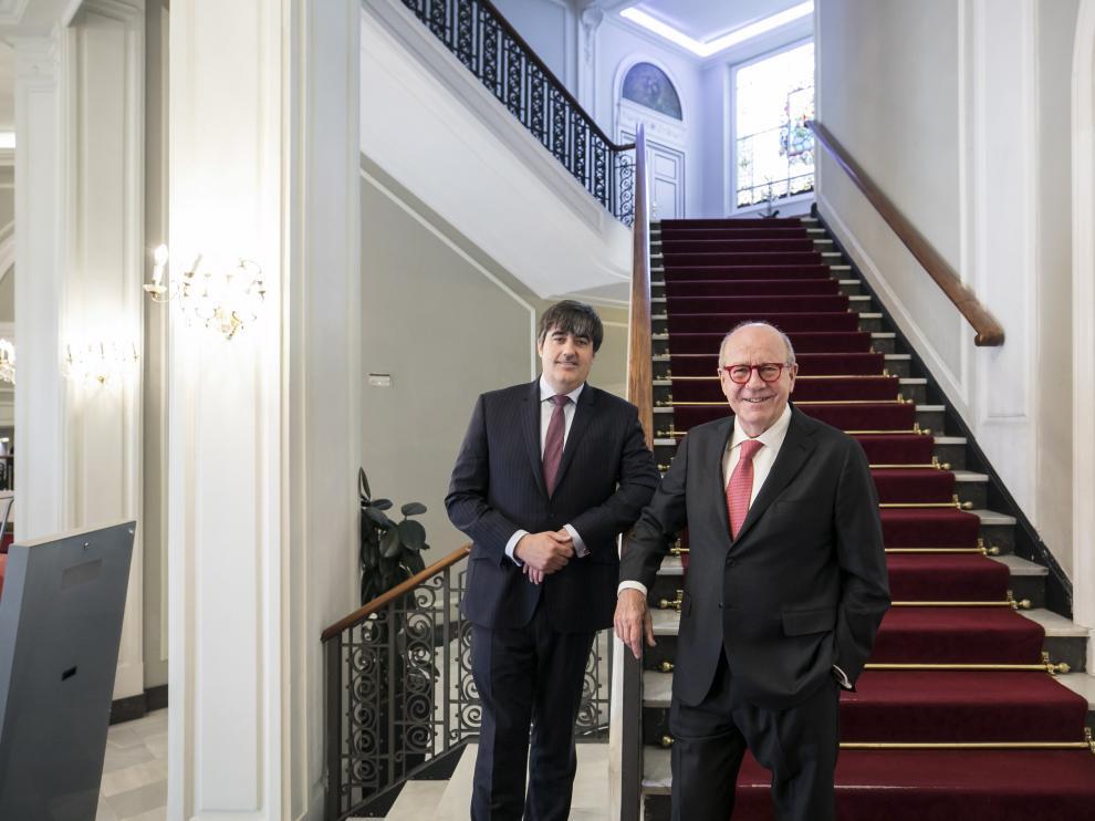 Carlos Aso (Andbank) y Joaquín Herrero (Merchbanc), en Zaragoza.