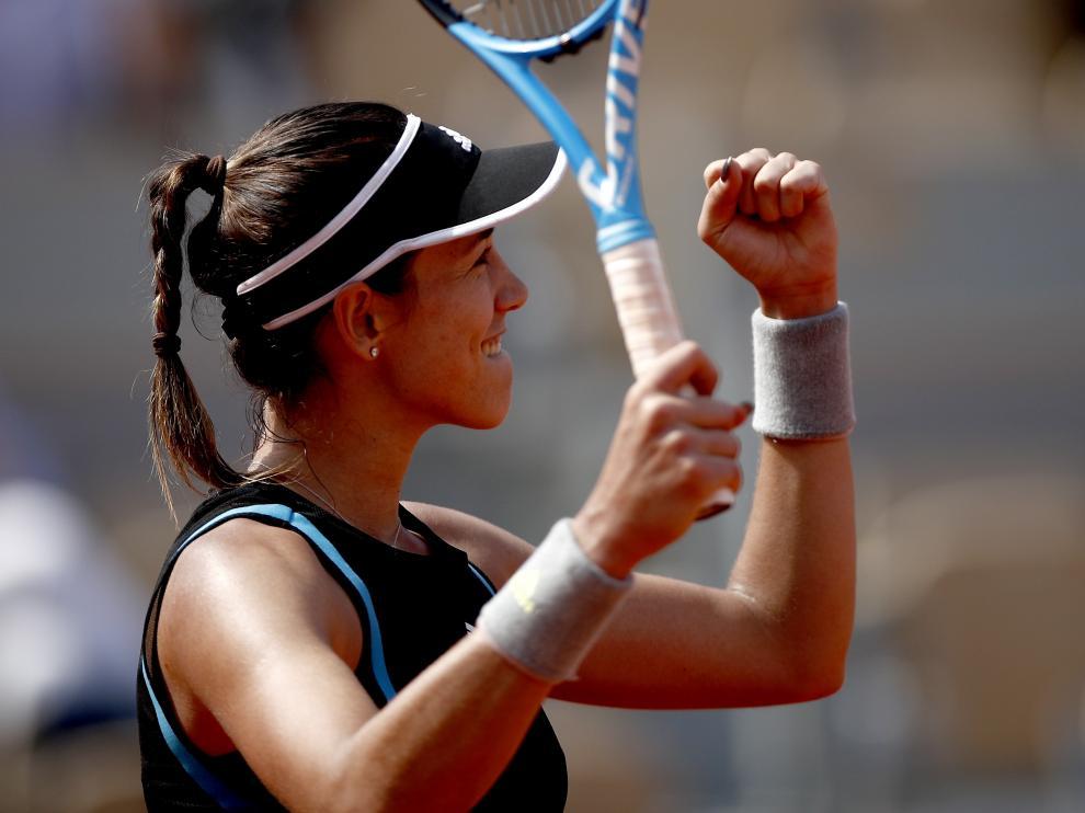 Garbiñe Muguruza celebra su victoria ante la ucraniana Elina Svitolina.