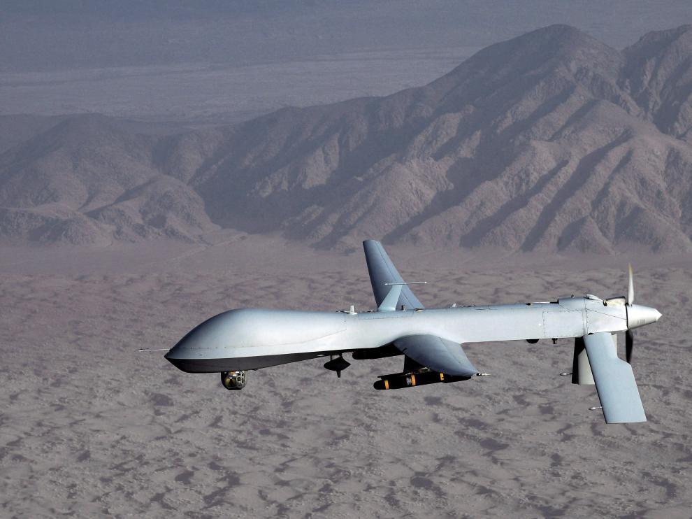 Imagen facilitada por las Fuerzas Aéreas estadounidenses muestran un MQ-1 Predator que sobrevuela una localización desconocida.