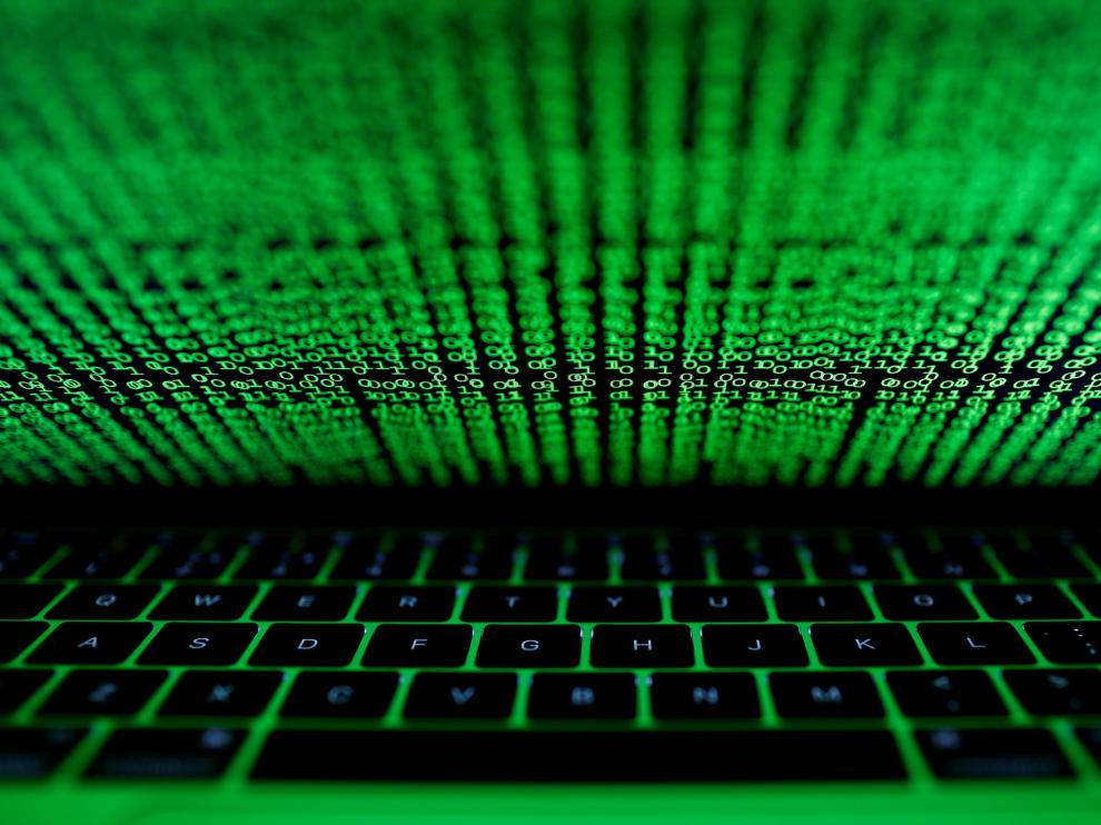 FILE PHOTO: A computer keyboard lit by a displayed cyber code is seen in this illustration picture taken on March 1,  2017. REUTERS/Kacper Pempel/Illustration/File Photo [[[REUTERS VOCENTO]]] BANKS-DATA/