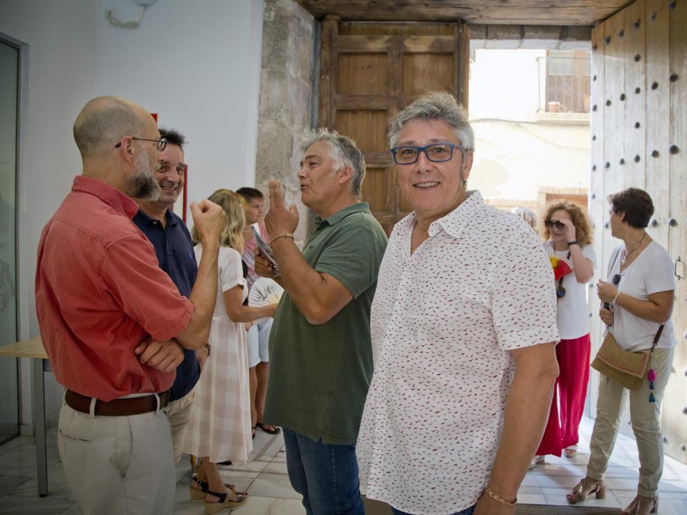 Julián Millán, en primer plano, minutos antes de la celebración de la conferencia